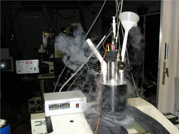 detail of the electrochemical cell with clouds of water vapour produced by the liquid nitrogen refrigerator